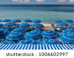beach umbrellas on the cote d'... | Shutterstock . vector #1006602997