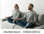 mindful couple meditating... | Shutterstock . vector #1006618411