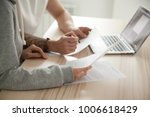 couple reading legal documents... | Shutterstock . vector #1006618429