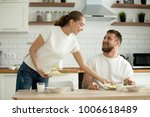 attractive caring wife serving... | Shutterstock . vector #1006618489