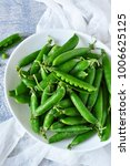fresh  young green peas in a...   Shutterstock . vector #1006625125