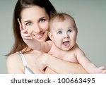 happy mother with baby | Shutterstock . vector #100663495