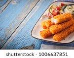 tasty oven baked fish fingers... | Shutterstock . vector #1006637851