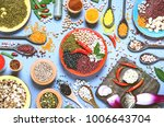 Small photo of Assortment of legumes bowls and various spices top view - Healthy food background flat lay of colorful kitchen table with beans and seeds from around the world - Concept of alternative protein diet