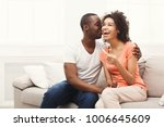 young balck couple happy about... | Shutterstock . vector #1006645609