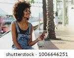 a happy dark skinned girl... | Shutterstock . vector #1006646251