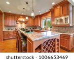 gourmet kitchen boasts a bar... | Shutterstock . vector #1006653469