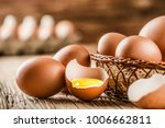 brown eggs in wooden basket.... | Shutterstock . vector #1006662811