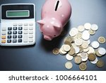 clculator with piggy bank and... | Shutterstock . vector #1006664101