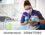 young female dentist drilling... | Shutterstock . vector #1006675585