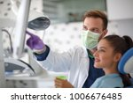 male dentist showing x ray to... | Shutterstock . vector #1006676485