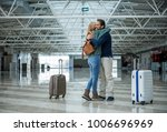 two cheerful adults hugging...   Shutterstock . vector #1006696969