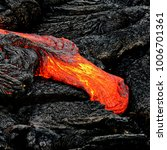 A Lava Flow Emerges From A Rock ...