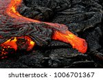 a lava flow emerges from a rock ... | Shutterstock . vector #1006701367