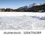 pond ice rink in the mountains... | Shutterstock . vector #1006706389
