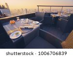 table setting on roof top... | Shutterstock . vector #1006706839