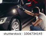 man checks the polishing with a ... | Shutterstock . vector #1006734145