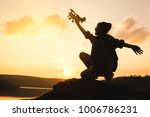 silhouette of girl playing... | Shutterstock . vector #1006786231