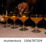 a row of whiskey cocktails are... | Shutterstock . vector #1006787209