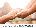 close up old and young hand of... | Shutterstock . vector #1006794781