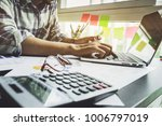 young accountant using credit... | Shutterstock . vector #1006797019
