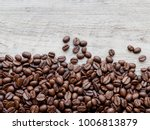 coffee beans on wood background | Shutterstock . vector #1006813879