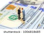 businessmen shaking hands on... | Shutterstock . vector #1006818685