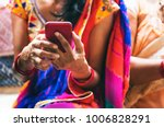 indian woman using mobile phone | Shutterstock . vector #1006828291