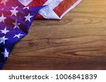 usa flag on brown wooden board. | Shutterstock . vector #1006841839