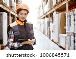woman with a clipboard in her... | Shutterstock . vector #1006845571