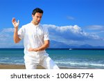 guy meditating by the sea | Shutterstock . vector #100684774