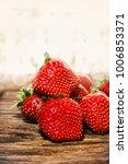 shot of strawberry fruits scene ... | Shutterstock . vector #1006853371
