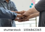 Small photo of Teamwork concept: Hands together of partnership. Hands of businessman and businesswomen join together after make a good deal.