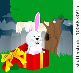 easter bunny in a gift box.... | Shutterstock .eps vector #1006873915