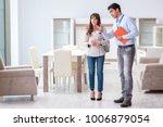 salesman explaining to woman... | Shutterstock . vector #1006879054