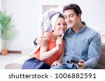 wife and husband looking at... | Shutterstock . vector #1006882591