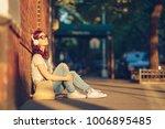 young girl with headphones... | Shutterstock . vector #1006895485