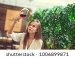 young girl with a wine glass in ... | Shutterstock . vector #1006899871