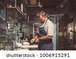 young chef cookilng in the... | Shutterstock . vector #1006915291