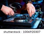 hands of the dj behind the... | Shutterstock . vector #1006920307