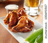 bbq buffalo wings with celery... | Shutterstock . vector #100693507