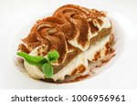 tiramisu cake on white plate | Shutterstock . vector #1006956961