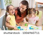 mother and kids are painting... | Shutterstock . vector #1006960711