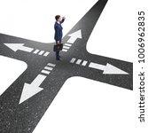 young businessman at crossroads ...   Shutterstock . vector #1006962835