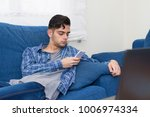 young at home with the mobile...   Shutterstock . vector #1006974334