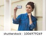 stylish beautiful woman in...   Shutterstock . vector #1006979269