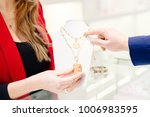 man buying a valentines gift in ...   Shutterstock . vector #1006983595