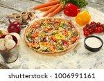 pizza with prosciutto and... | Shutterstock . vector #1006991161