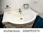 dirty and clean bathroom sink ... | Shutterstock . vector #1006992574