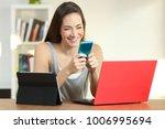 beautiful girl laughing using... | Shutterstock . vector #1006995694